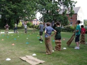 Madcats take part in a sack race at the Madcats Olympics on St Mark's Green