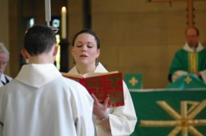 Anne reads from the Gospel during the Parish Eucharist