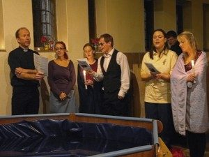 Singing around the full immersion baptismal pool at night service