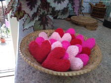Wicker basket containing small knitted hearts