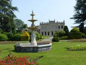Fountain in garden with Brodsworth Hall in the background